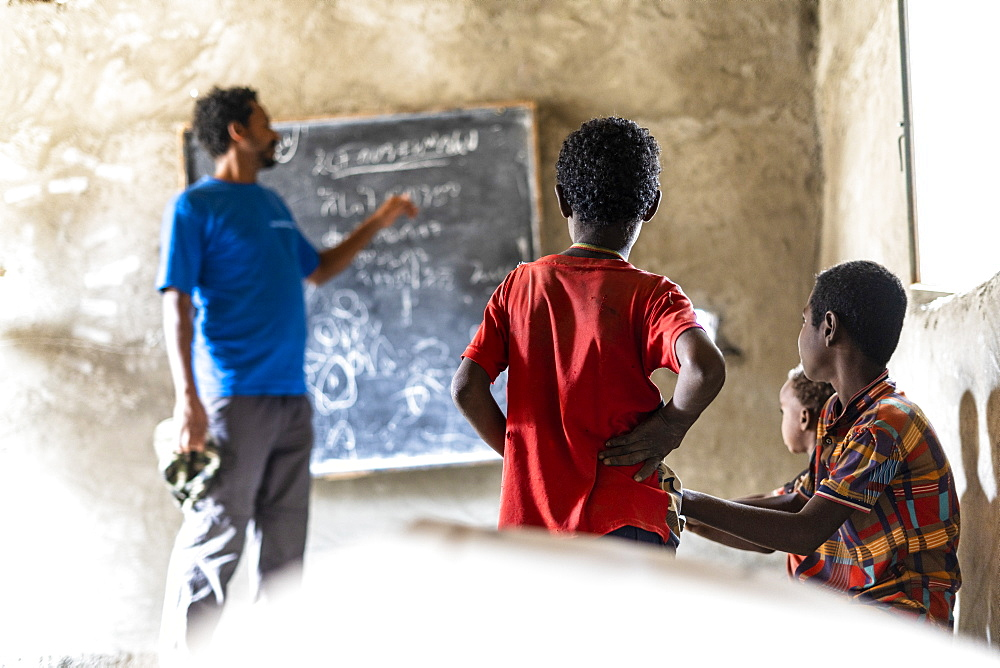 Teacher and kids in school classroom, Melabday, Asso Bhole, Danakil Depression, Afar Region, Ethiopia, Africa