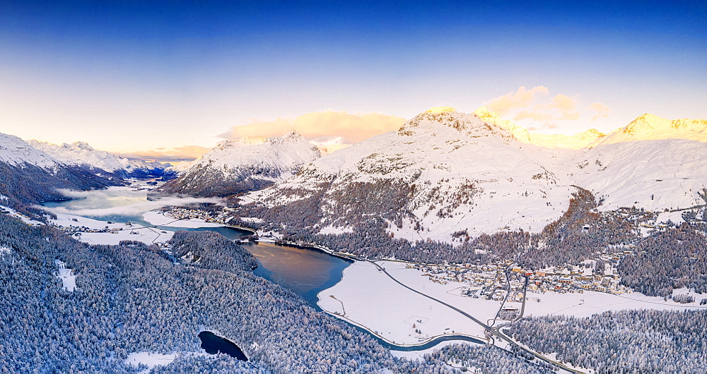 Aerial view by drone of Lej Da Champfer, Silvaplana, snowy Piz Da La Margna and Piz Polaschin, Engadine, canton of Graubunden, Switzerland, Europe