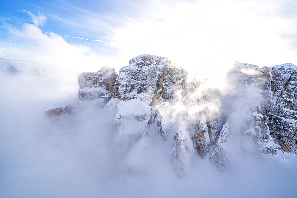 Mist over the snowy peaks of Sella Group, Dolomites, South Tyrol, Italy, Europe