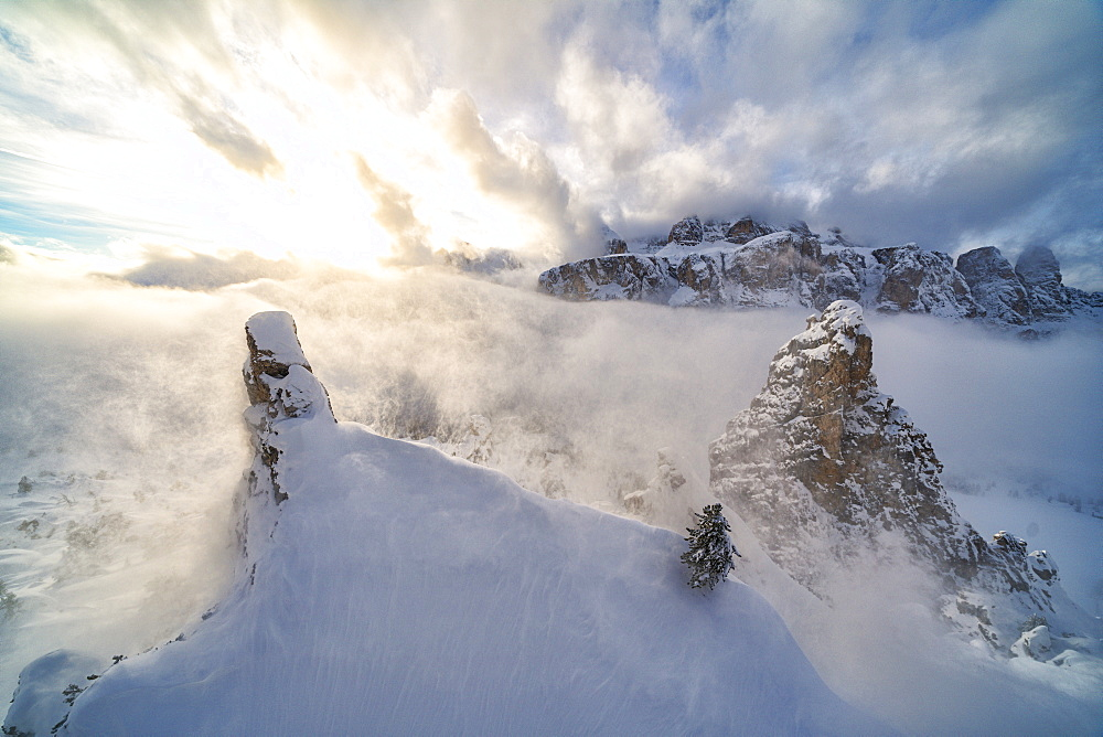 Aerial view of Sella covered with snow from Cir group, Puez-Odle Nature Park, Gardena Pass, Dolomites, South Tyrol, Italy, Europe