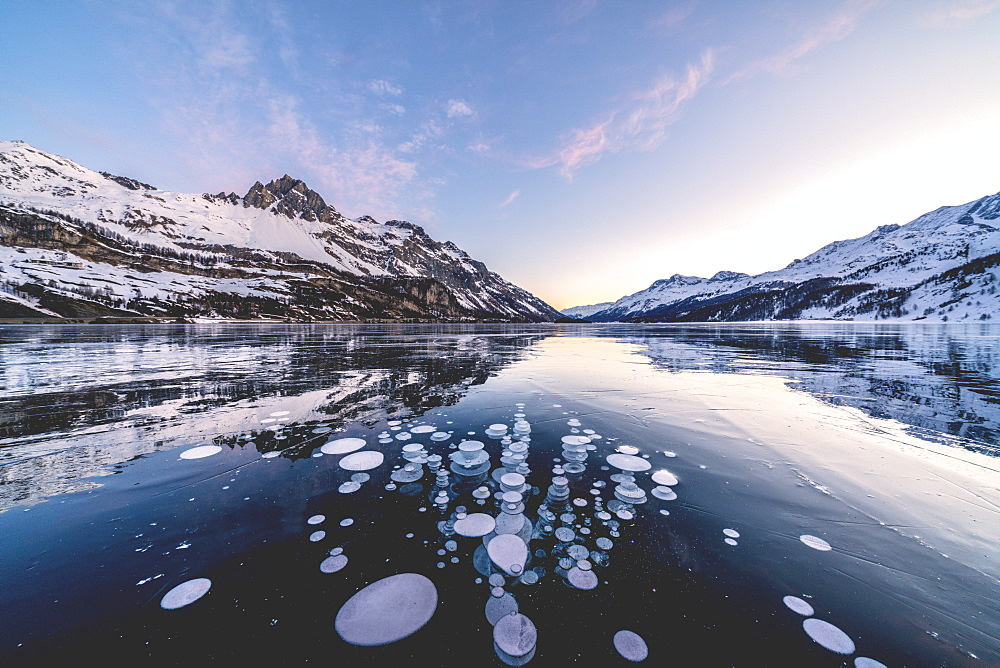 Ice bubbles trapped in Lake Sils with Piz Lagrev in background, Engadine, canton of Graubunden, Switzerland, Europe