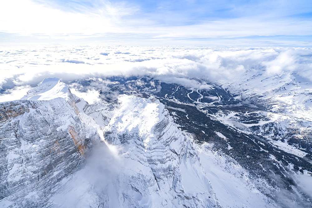 Monte Pelmo surrounded by a sea of clouds in winter, aerial view, Dolomites, Belluno province, Veneto, Italy