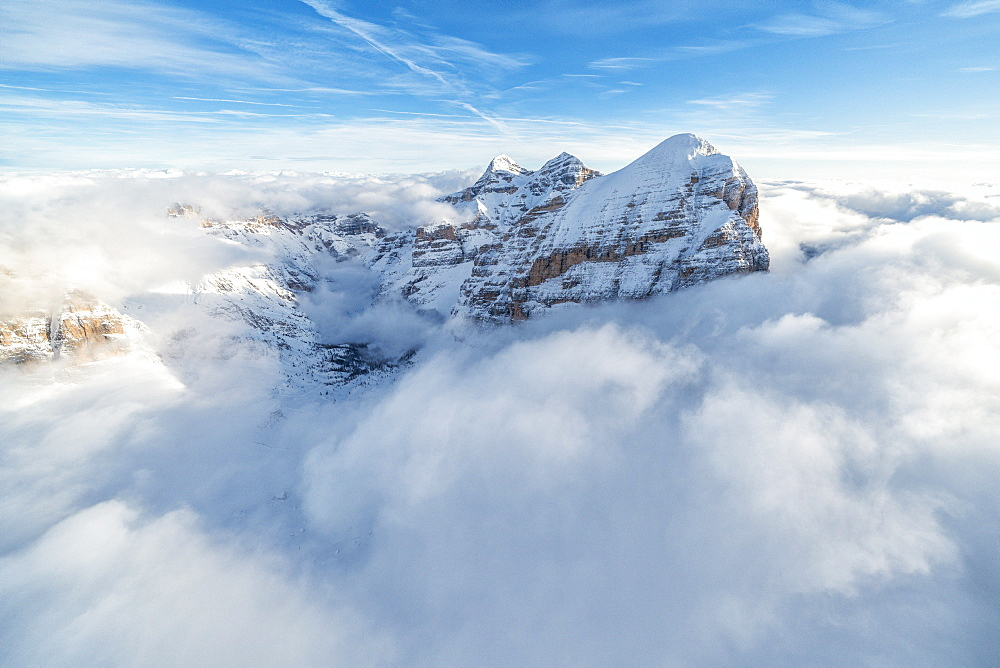 Aerial view of the snow capped Tofane group in a sea of clouds, Dolomites, Belluno province, Veneto, Italy, Europe