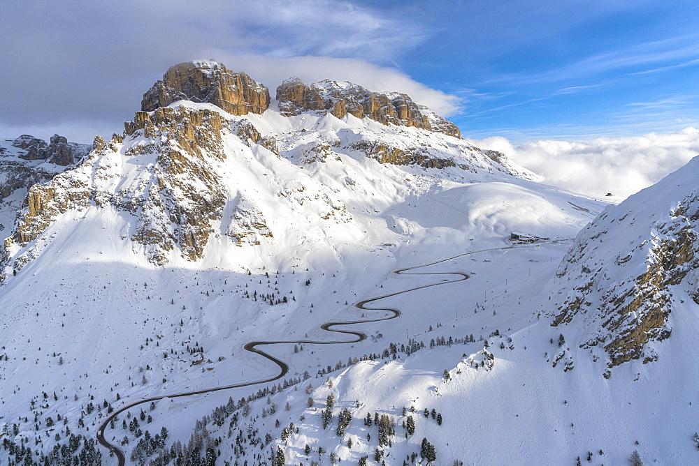 Winding road in the snow, aerial view, Pordoi Pass, Dolomites, Trentino-Alto Adige, Italy - 1179-4556