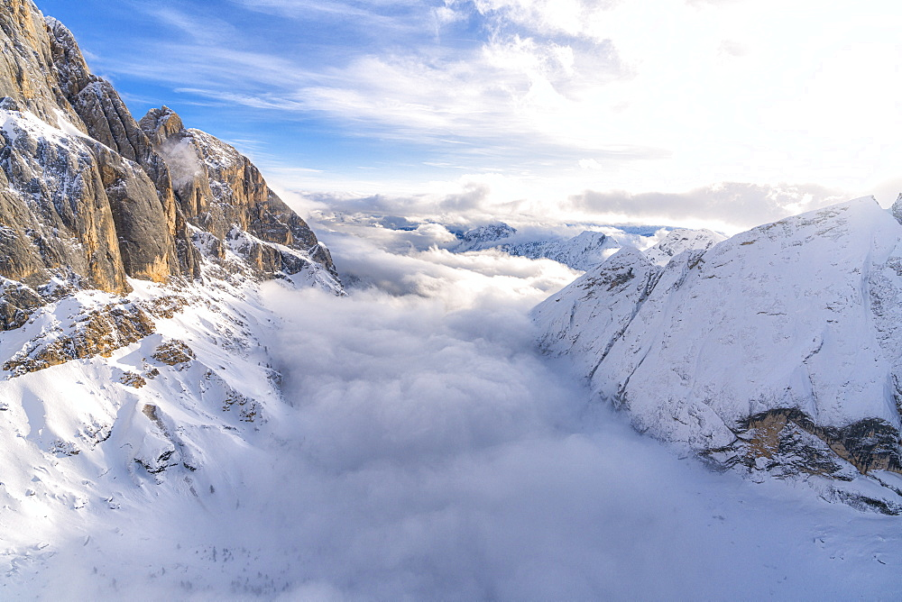 Aerial view of Valle Ombretta covered by clouds from Marmolada, Dolomites, Veneto, Italy, Europe