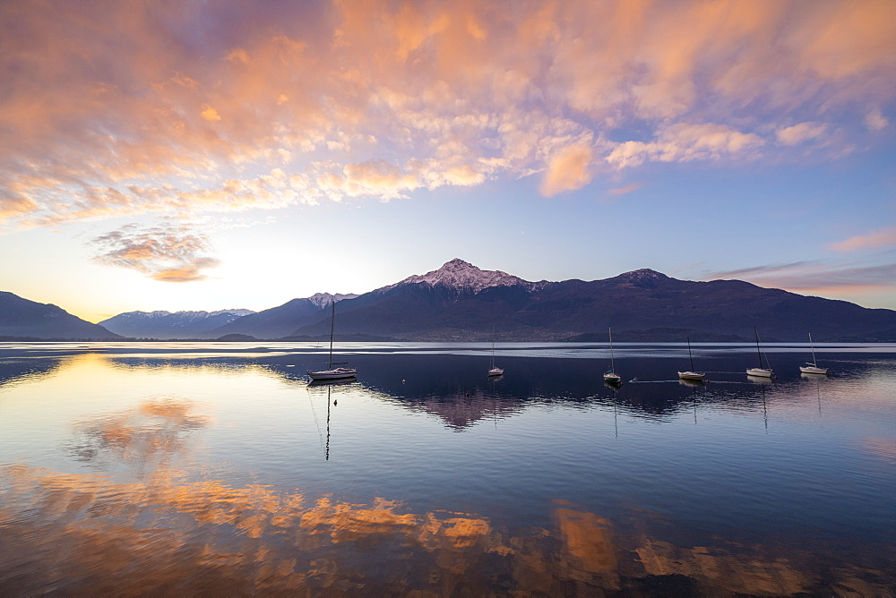Clouds at sunrise mirrored in Lake Como, Domaso, Lombardy, Italy