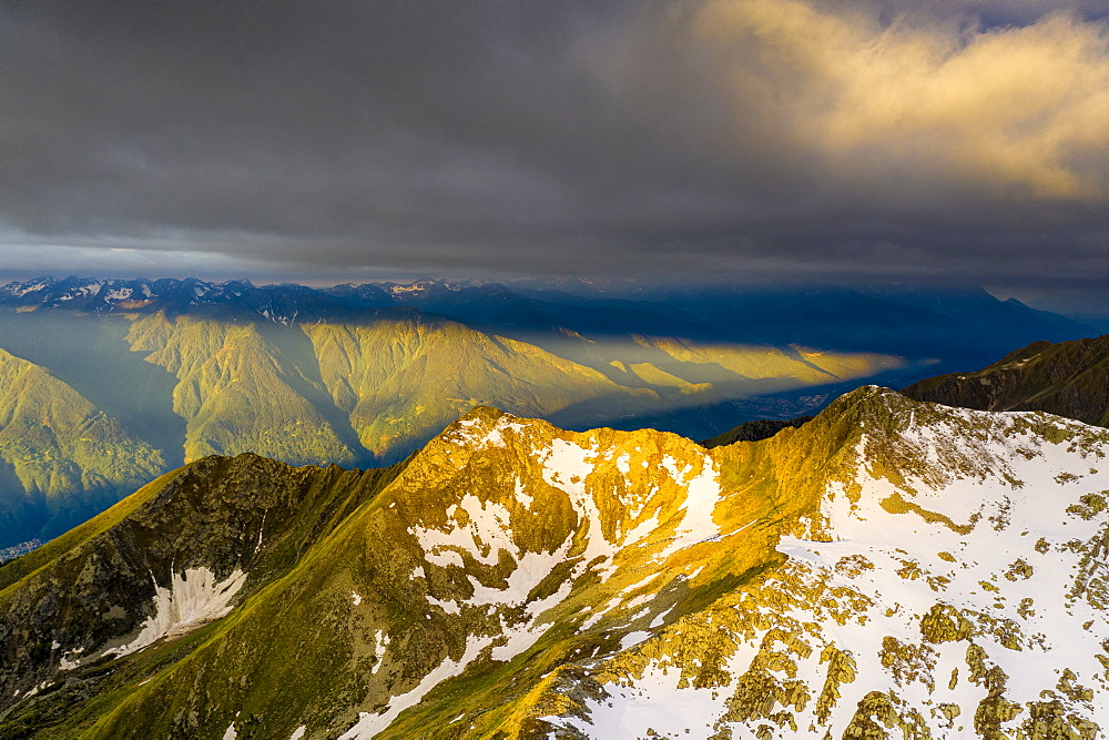 Sunrise over Orobie Alps from Sasso Bianco, aerial view, Valmalenco, Sondrio province, Valtellina, Lombardy, Italy, Europe
