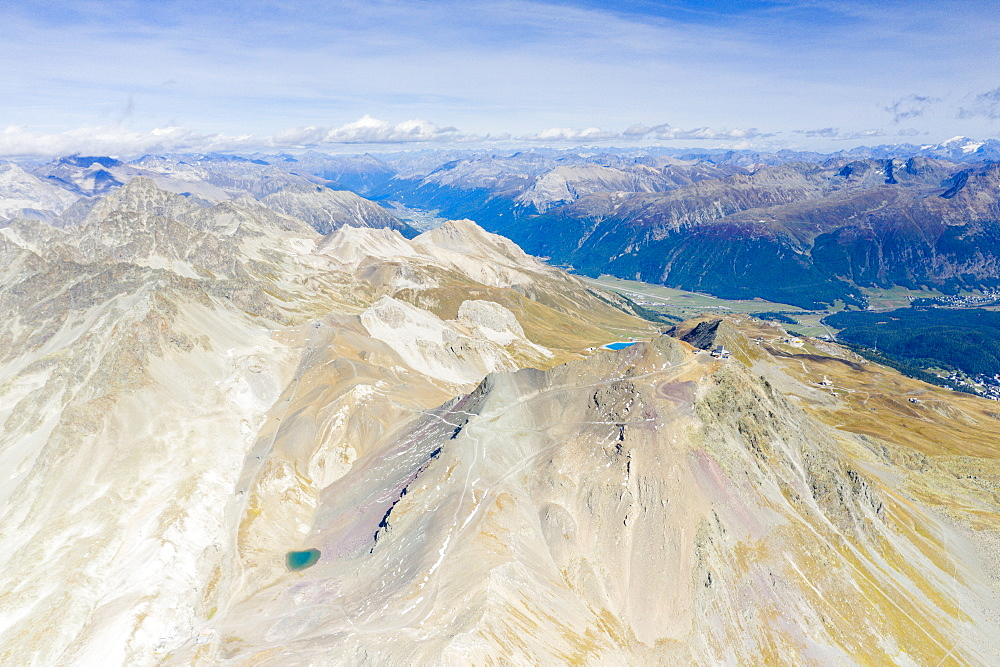 Aerial panoramic of majestic Piz Nair mountain and lake Lej Da La Pesch, Engadine, canton of Graubunden, Switzerland (drone)