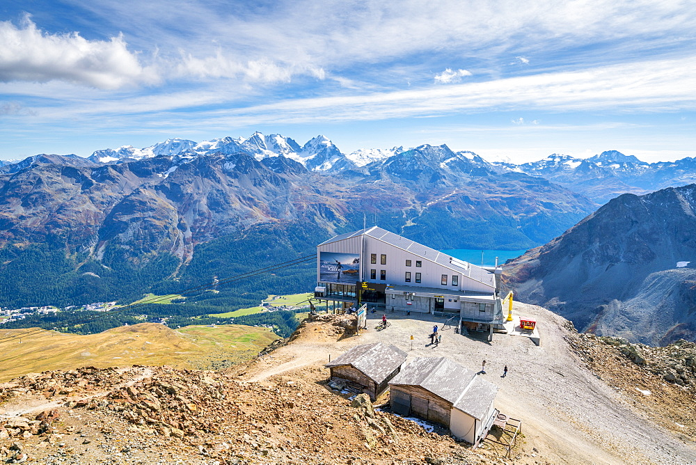 Tourists at the cable car station on top of rocky peak of Piz Nair, Engadine, canton of Graubunden, Switzerland (drone)
