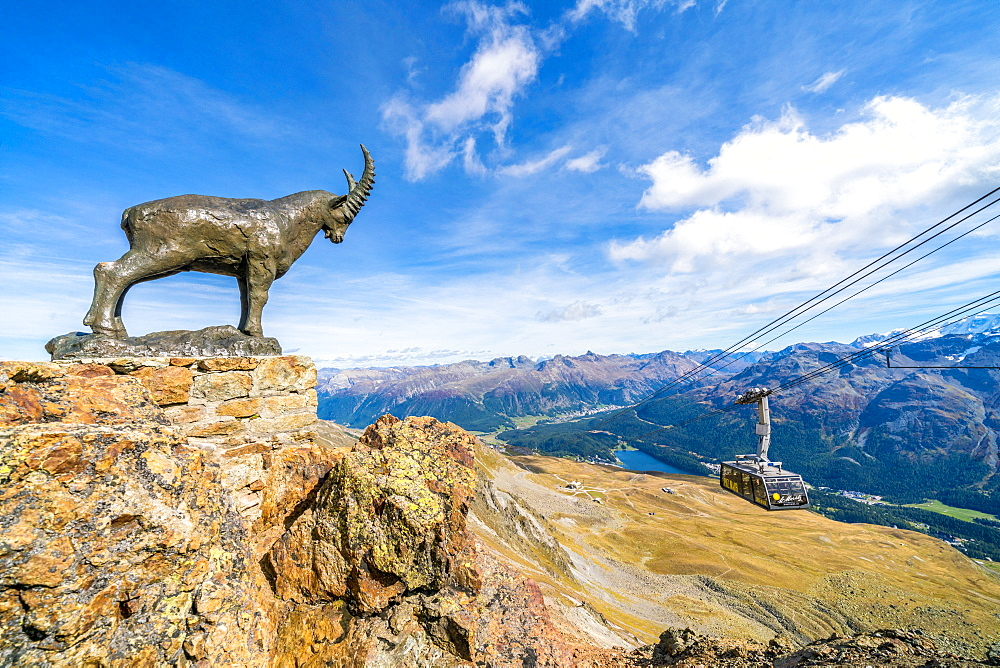 Ibex statue on rocks surrounding the cable car going up to Piz Nair, St. Moritz, Engadine, canton of Graubunden, Switzerland