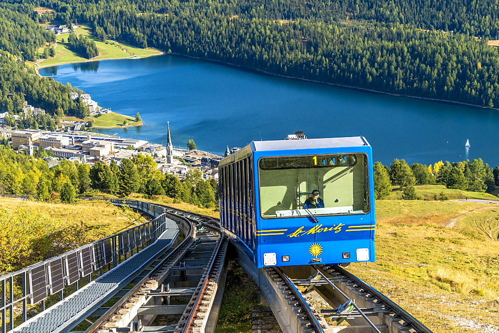 Funicular car uphill with St. Moritz lake and village in the background, Engadine, canton of Graubunden, Switzerland