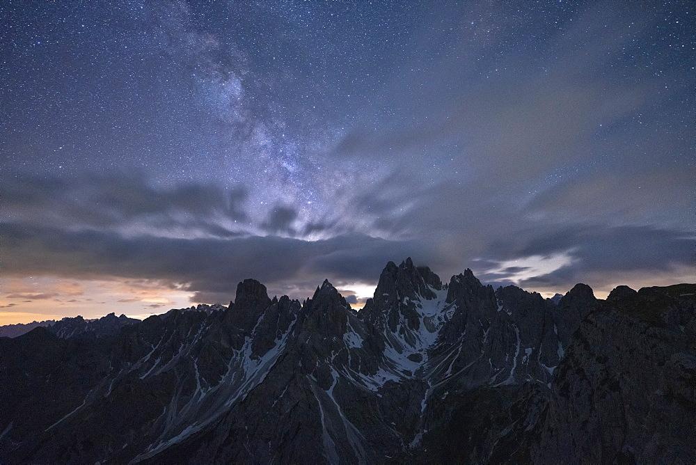 Milky Way and stars over the sharp pinnacles of Cadini di Misurina, Dolomites, Belluno province, Veneto, Italy, Europe - 1179-4655
