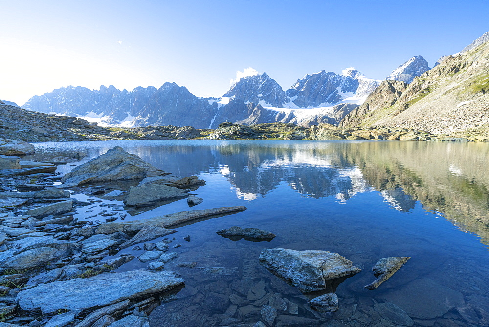 Bernina Group reflected in the clear water of Forbici lake at dawn, Valmalenco, Valtellina, Sondrio province, Lombardy, Italy, Europe - 1179-4678