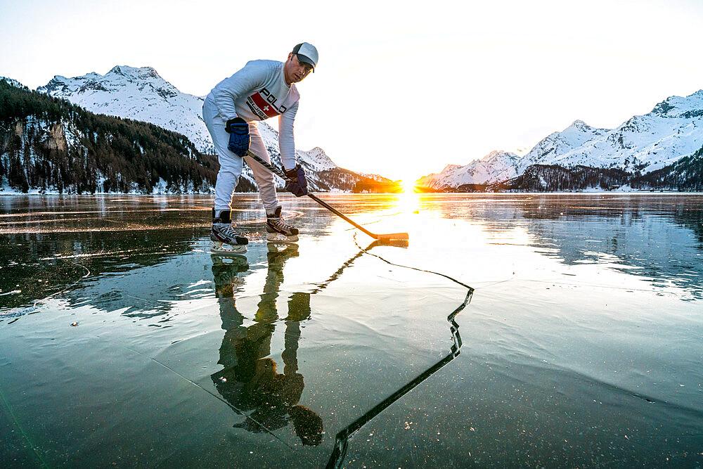 Front view of ice hockey player on cracked surface of frozen Lake Sils, Engadine, Graubunden canton, Switzerland, Europe - 1179-4708