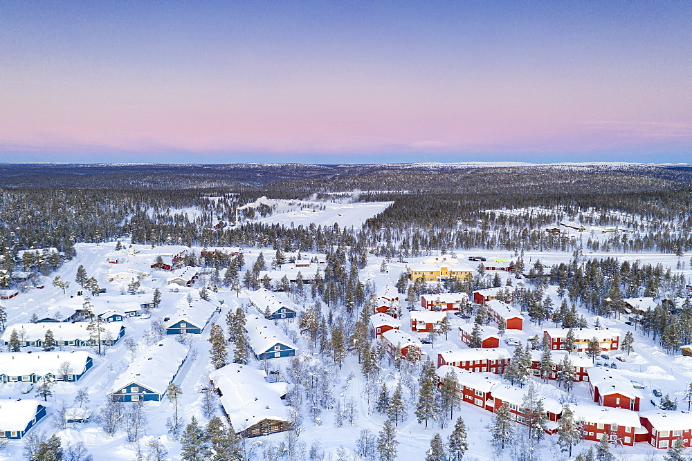 Aerial view of snow capped forest and Saariselka winter tourist resort at sunrise, Inari, Lapland, Finland, Europe - 1179-4822