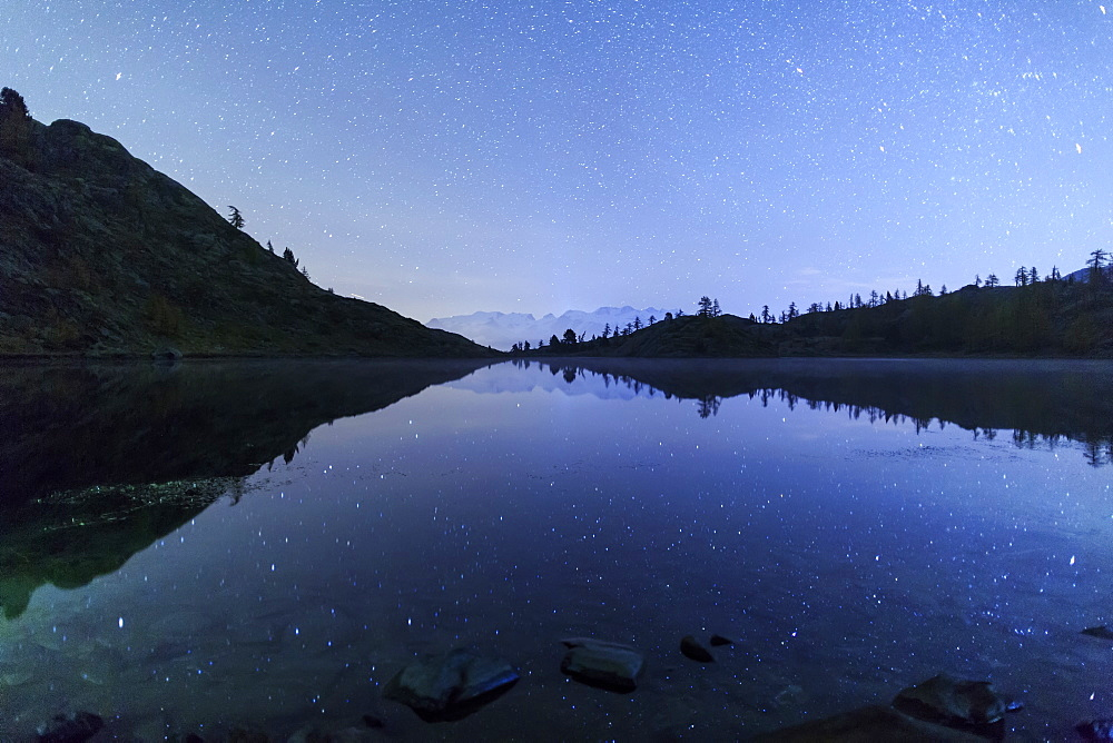 Starry night on Mount Rosa seen from Lake Vallette, Natural Park of Mont Avic, Aosta Valley, Graian Alps, Italy, Europe