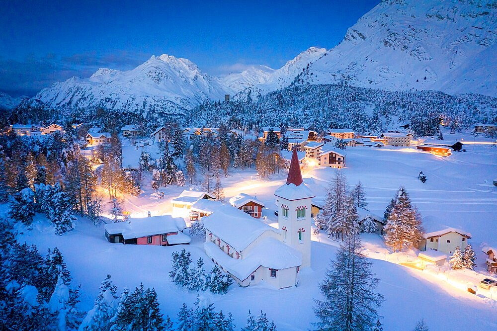 Dusk over Chiesa Bianca and Maloja village covered with snow, Bregaglia, Engadine, Graubunden Canton, Switzerland, Europe - 1179-4891