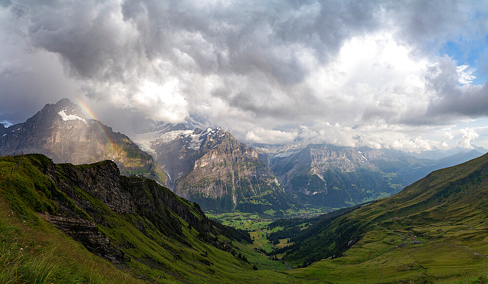 Panoramic of green valley surrounding Grindelwald and Bernese Alps lit by rainbow, First, Canton of Bern, Switzerland - 1179-5007