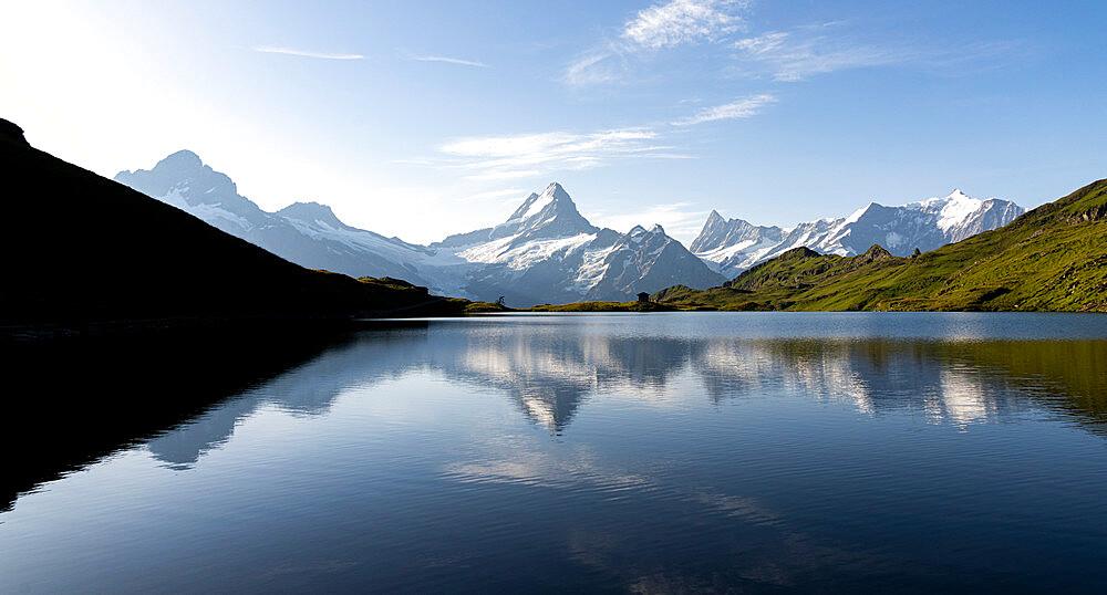 Schreckhorn mountain reflected in Bachalpsee lake at dawn, Grindelwald, Bernese Oberland, Bern Canton, Switzerland - 1179-5013