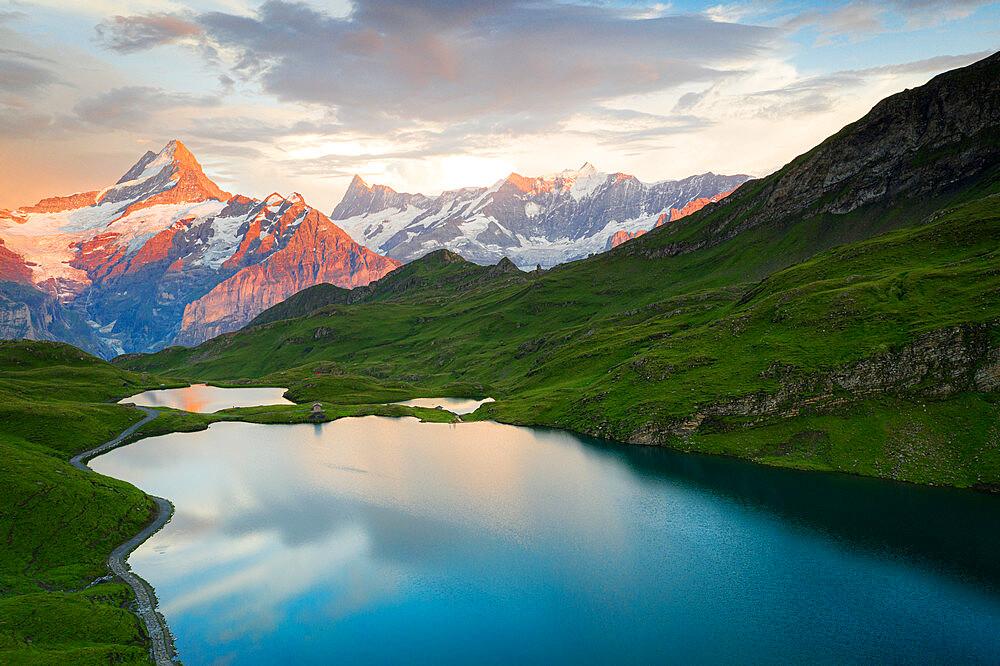 Schreckhorn and Finsteraarhorn peaks reflected in Bachalpsee lake at sunset, Grindelwald, Bernese Oberland, Switzerland - 1179-5023
