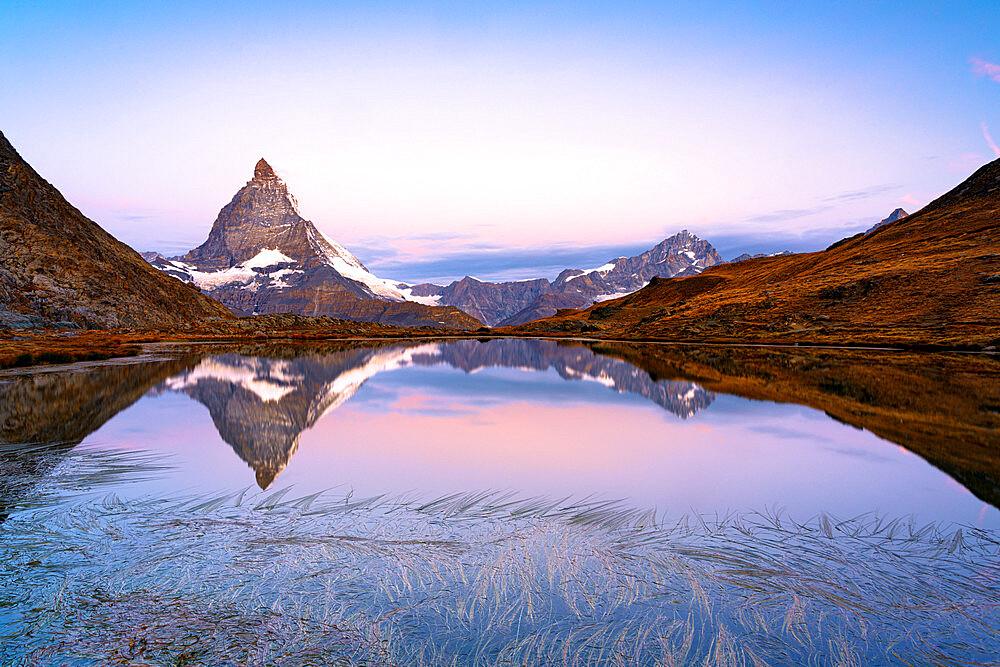 Matterhorn reflected in Riffelsee lake at dawn, Gornergrat, Zermatt, canton of Valais, Switzerland - 1179-5035