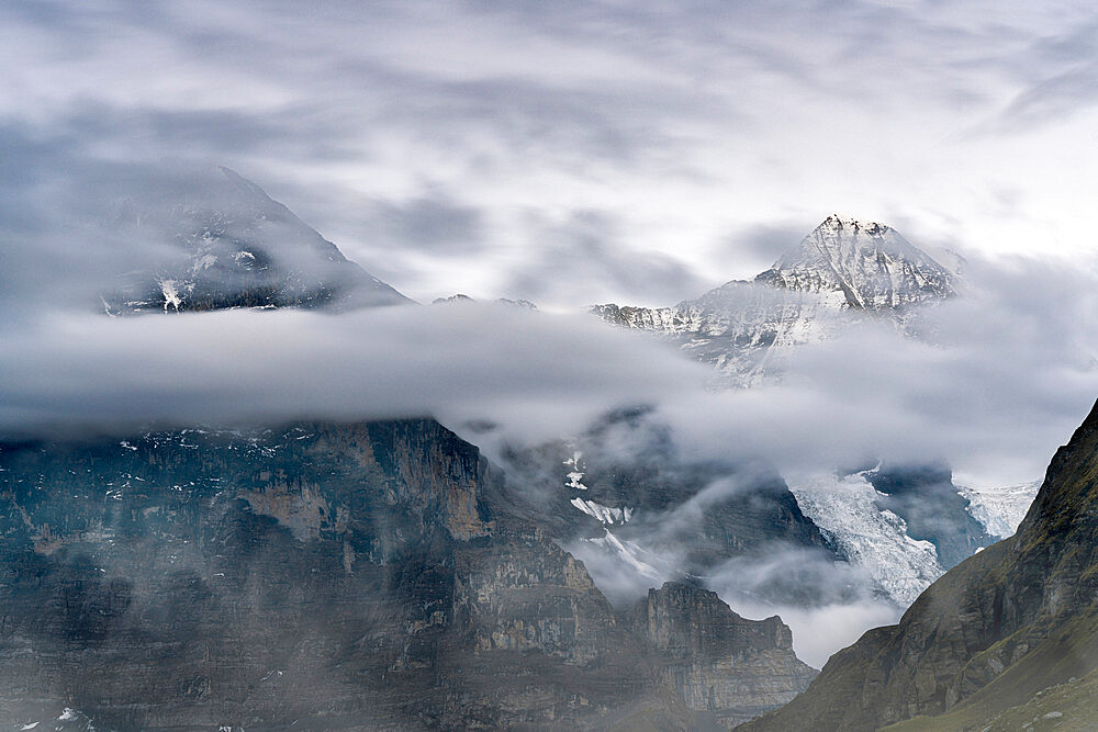 The Eiger and Monch mountain peaks in the cloudy sky, Mannlichen, Grindelwald, Bernese Oberland, Bern Canton, Switzerland - 1179-5039