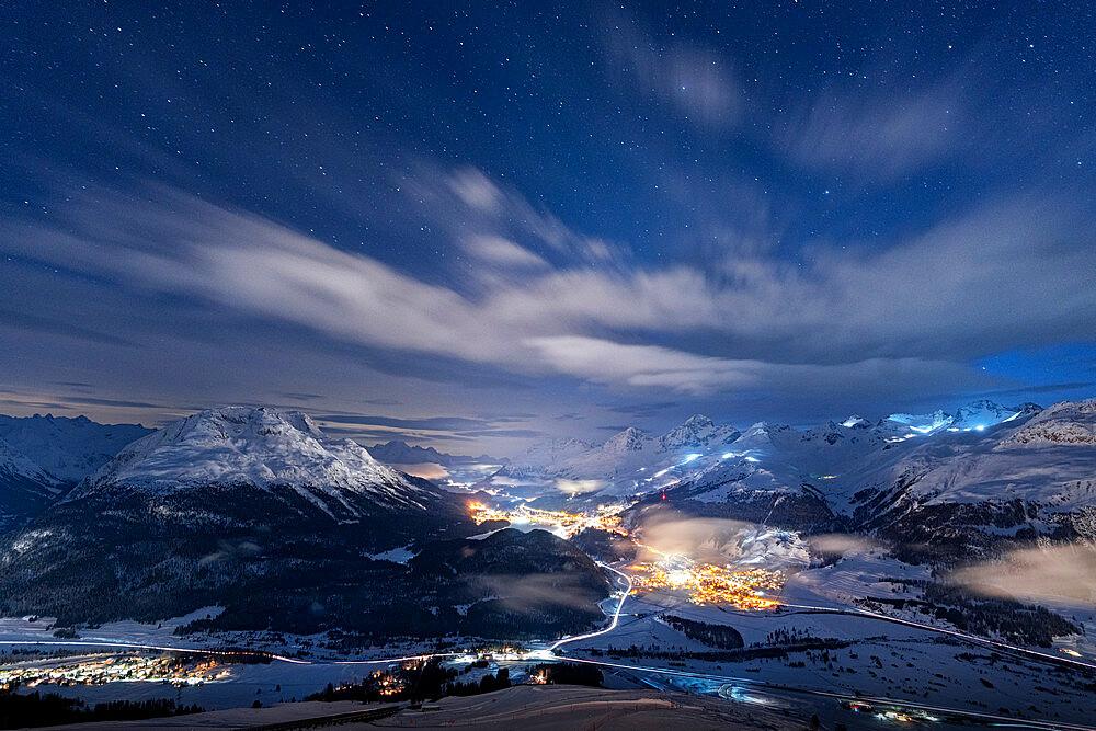 Starry winter sky on St. Moritz village and Upper Engadin covered with snow view from Muottas Muragl, Graubunden, Switzerland - 1179-5045