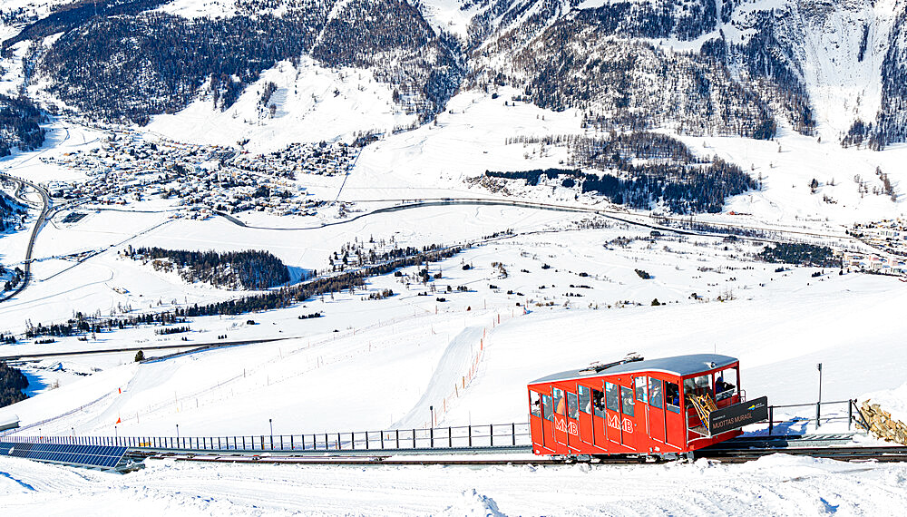 Tourists enjoying the journey on funicular in the snowy landscape, Muottas Muragl, Samedan, Graubunden, Engadine, Switzerland - 1179-5047