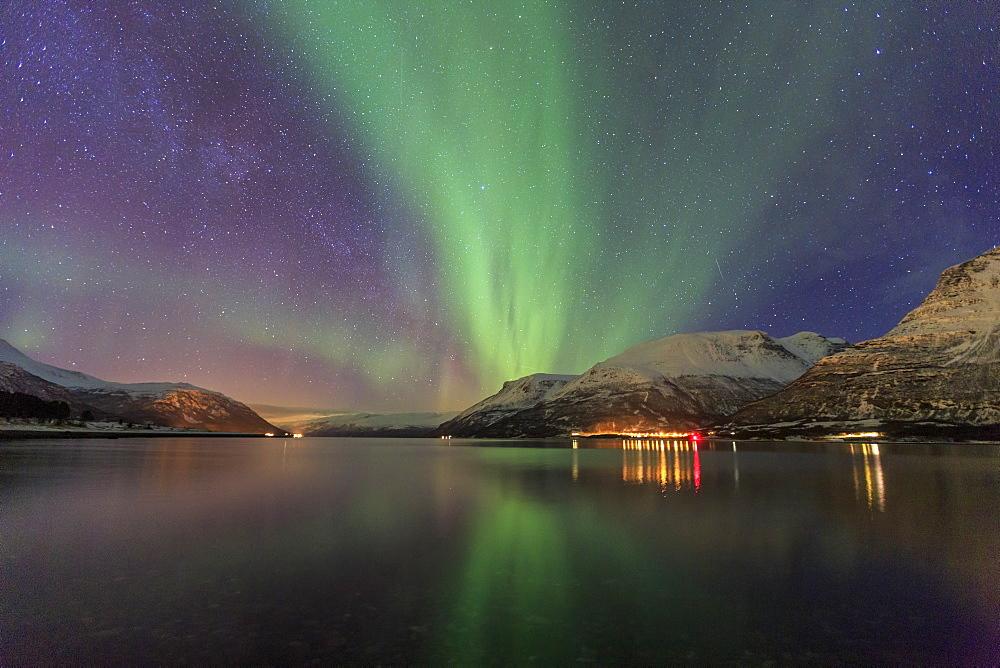The Northern Lights illuminates the icy sea, Oteren, Storfjorden, Lyngen Alps, Troms, Lapland, Norway, Scandinavia, Europe