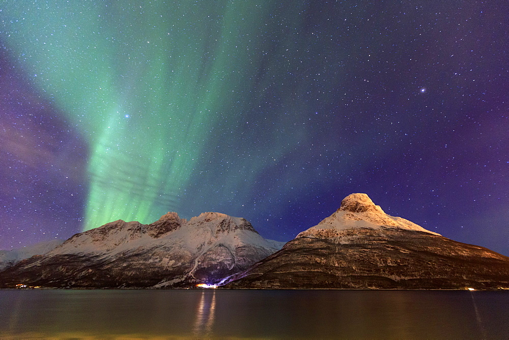 The Northern Lights illuminates the snowy peaks Oteren Storfjorden, Lyngen Alps, Troms, Lapland, Norway, Scandinavia, Europe