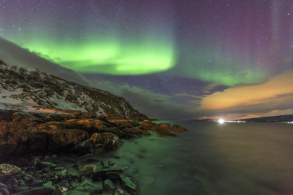 Northern Lights on the icy sea of Svensby, Lyngen Alps, Troms, Lapland, Norway, Scandinavia, Europe