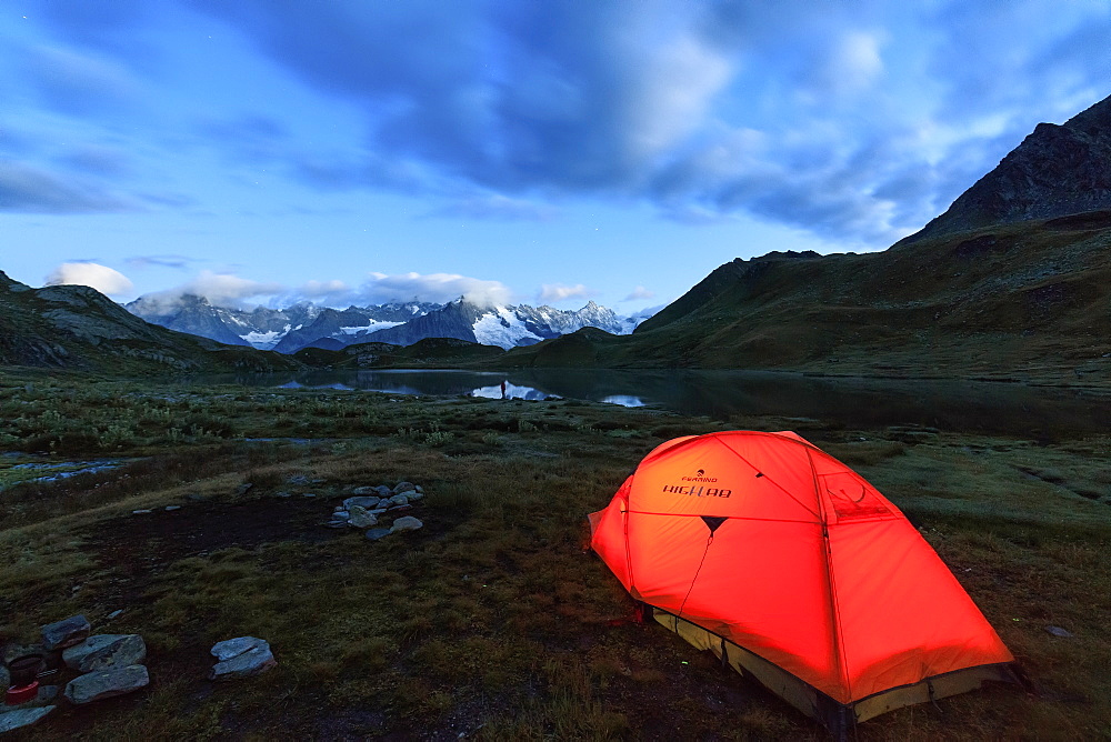 Lights of a tent around Fenetre Lakes at dusk, Ferret Valley, Saint Rhemy, Grand St Bernard, Aosta Valley, Italy, Europe