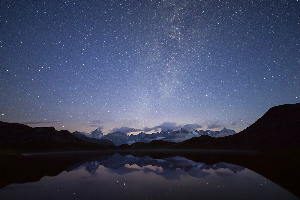 Starry summer sky on Fenetre Lakes and the high peaks, Ferret Valley, Saint Rhemy, Grand St Bernard, Aosta Valley, Italy, Europe