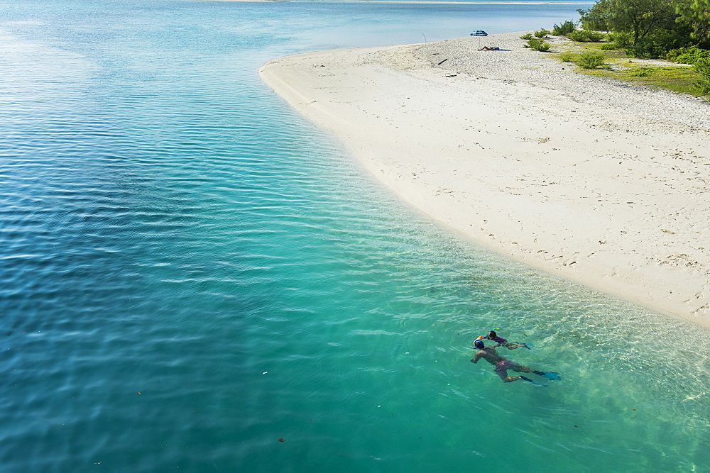 Man snorkeling in the beautiful lagoon of Ouvea, Loyalty Islands, New Caledonia