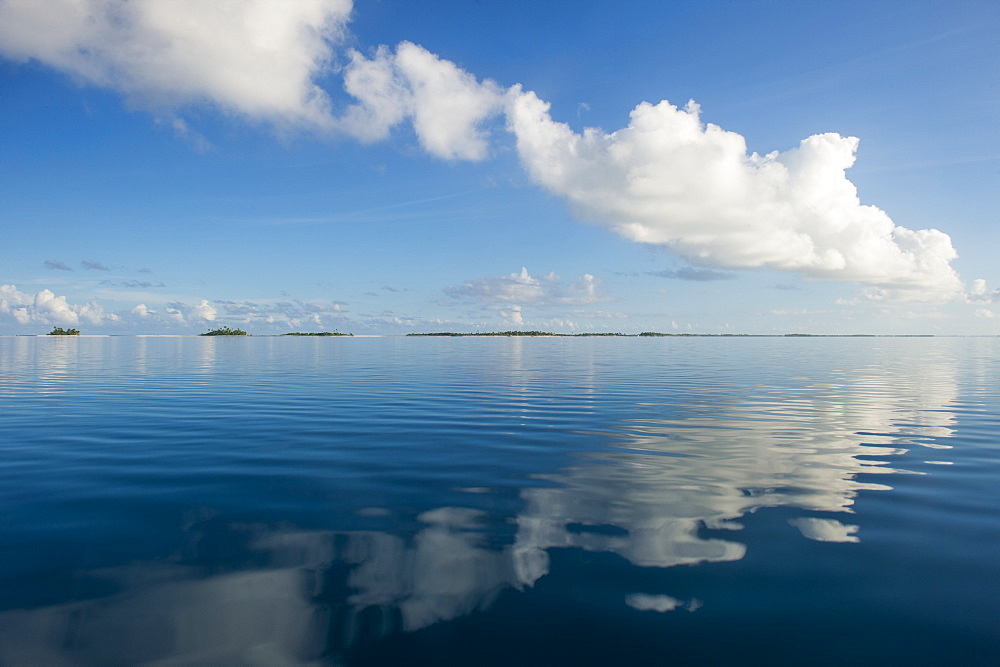Clouds reflecting in the calm waters of Tikehau, Tuamotus, French Polynesia, Pacific