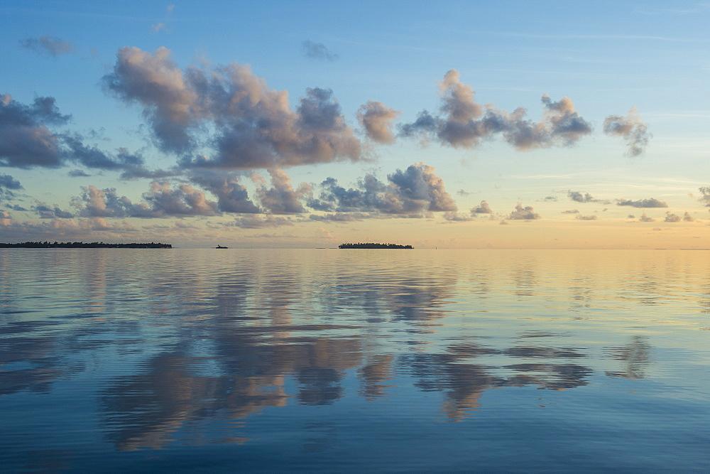 Sunset over the calm waters of Tikehau at sunset, Tuamotus, French Polynesia - 1184-1135