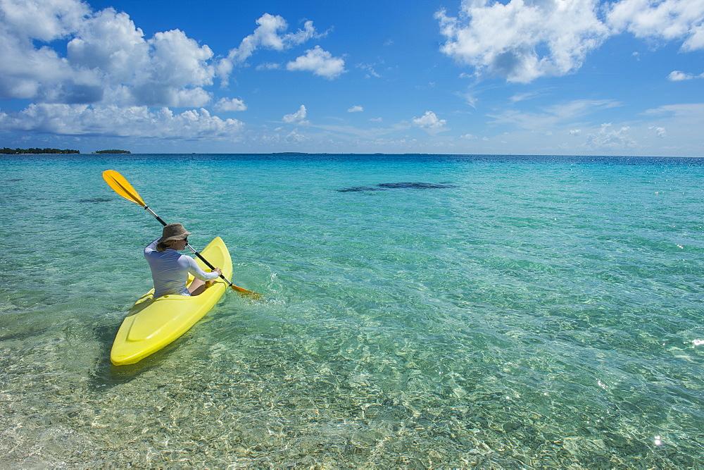Woman kayaking in the turquoise waters of Tikehau, Tuamotus, French Polynesia - 1184-1136