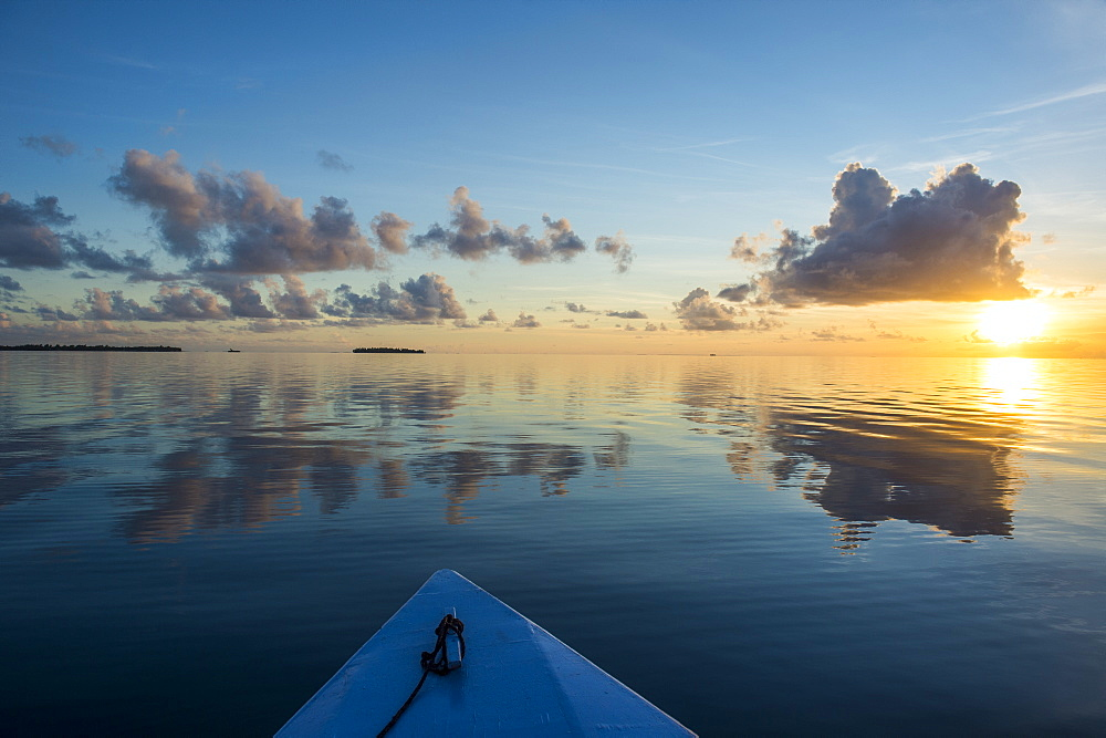 Sunset over the calm waters of Tikehau, Tuamotus, French Polynesia, Pacific