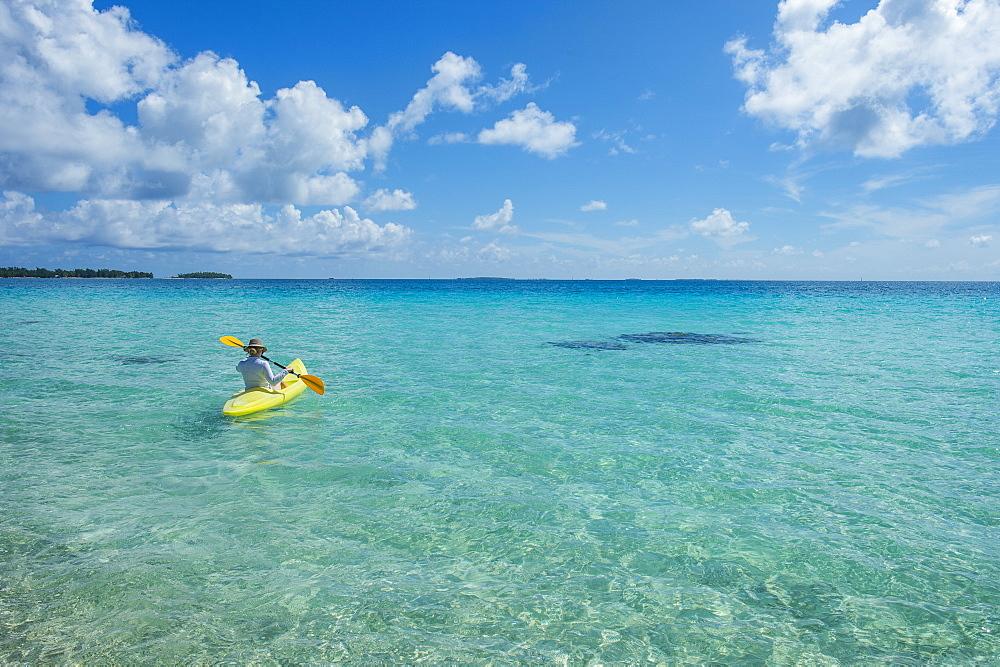 Woman kayaking in the turquoise waters of Tikehau, Tuamotus, French Polynesia - 1184-1142