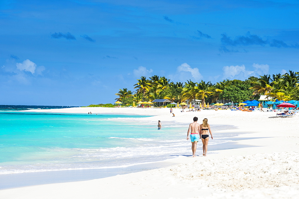 Couple walking on world class Shoal Bay East beach, Anguilla, Caribbean, British Oversea territory, United Kingdom