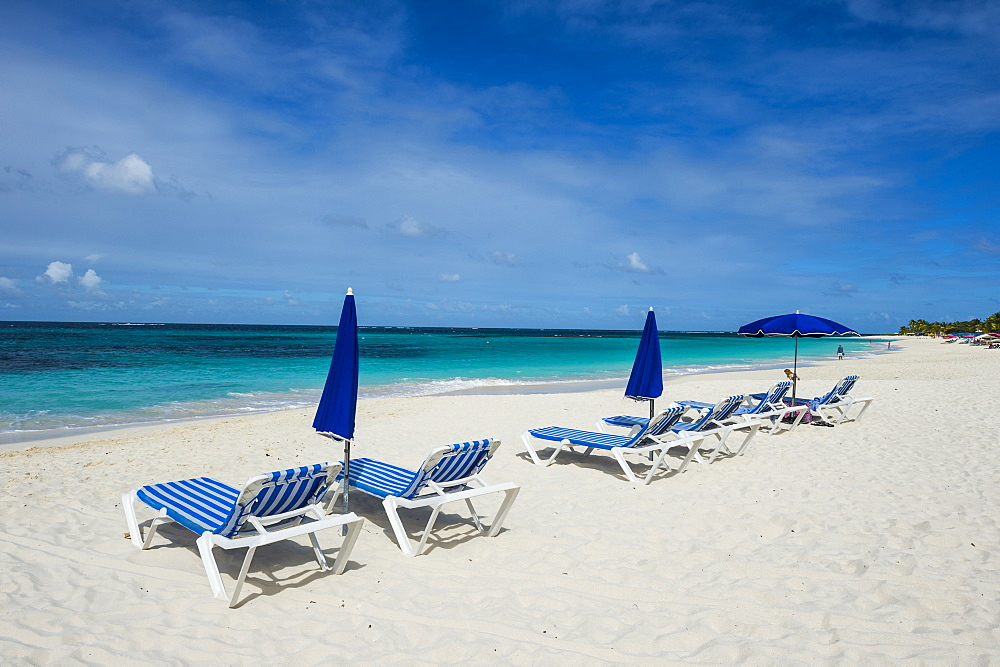 Sun loungers on world class Shoal Bay East beach, Anguilla, Caribbean, British Oversea territory, United Kingdom