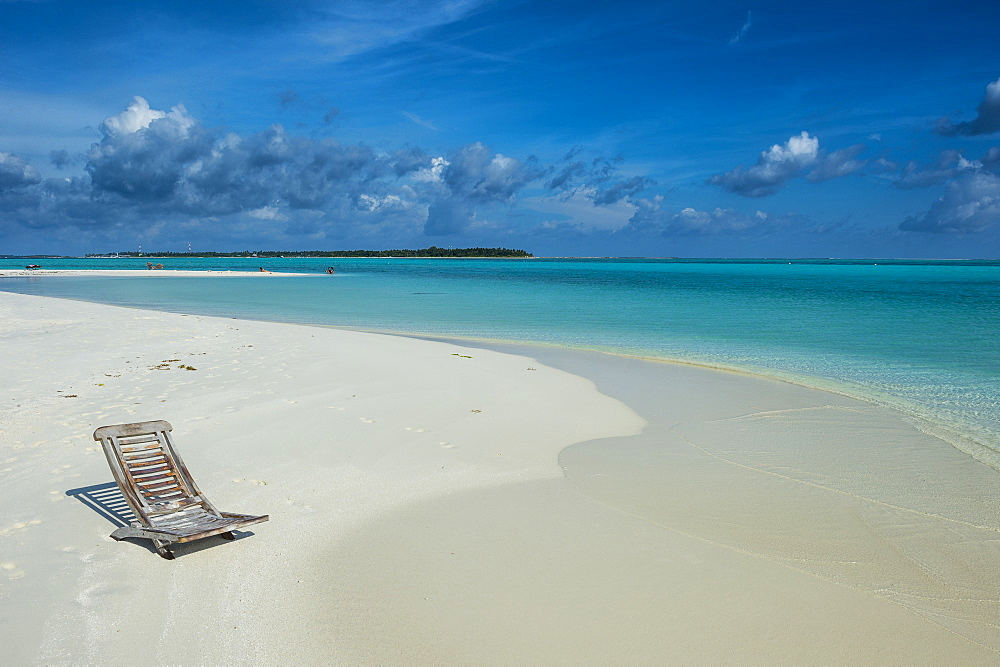 Sun chair on a white sand beach and turquoise water, Sun Island Resort, Nalaguraidhoo island, Ari atoll, Maldives