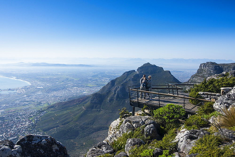 Family enjoying the view from Table mountain ove Cape town, South Africa