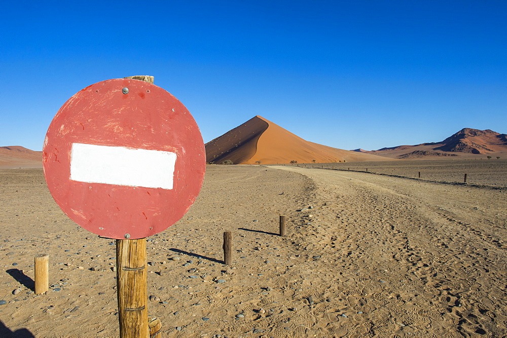 No passing sign in front of the giant sand Dune 45, Sossusvlei, Namib-Naukluft National Park, Namibia, Africa