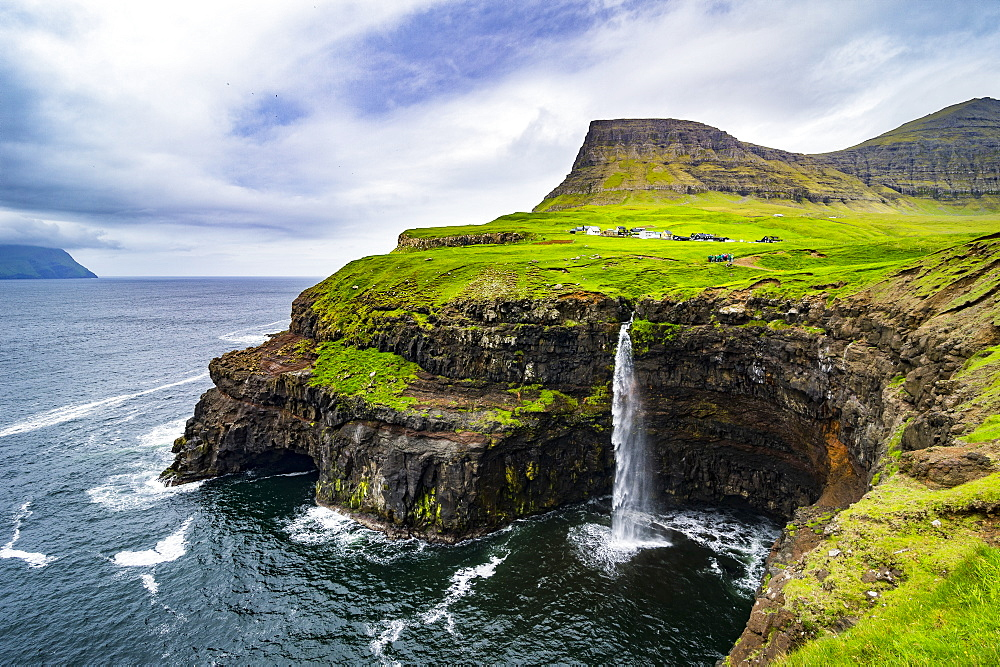 Gasadalur waterfall into the ocean, Vagar, Faroe Islands, Denmark, Europe