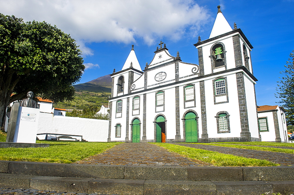 Paroquia de Sao Mateus church below Ponta do Pico, highest mountain of Portugal, Island of Pico, Azores, Portugal, Atlantic, Europe