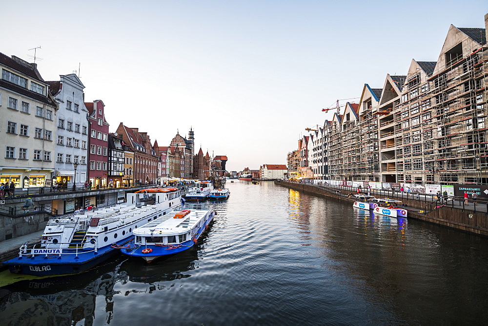Hanseatic League houses on the Motlawa River at sunset in the pedestrian zone of Gdansk, Poland, Europe