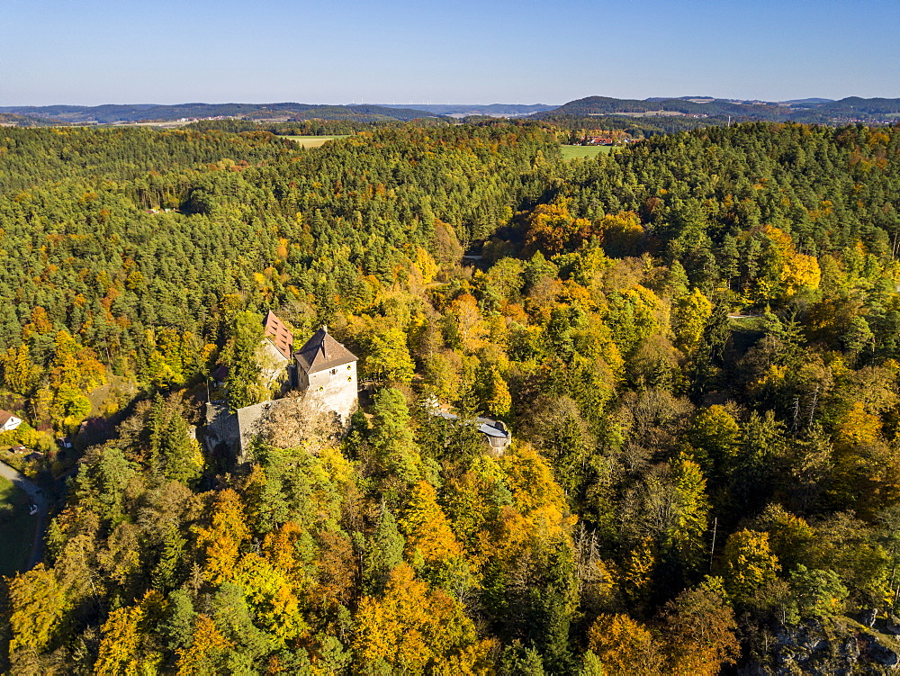 Rabenstein Castle in the Ahornvalley in autumn, Franconian Switzerland, Bavaria, Germany (drone)