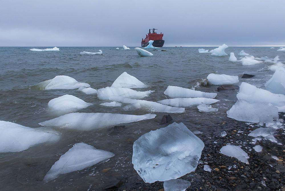 Icebreaker anchoring behind an iceberg, Champ Island, Franz Josef Land archipelago, Arkhangelsk Oblast, Arctic, Russia, Europe