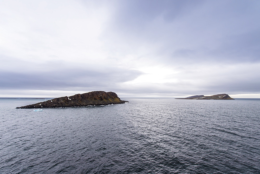 Moody lights over Cape Trieste, Franz Josef Land archipelago, Arkhangelsk Oblast, Arctic, Russia, Europe